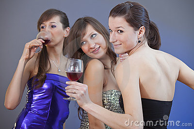 Women dancing with glasses wine