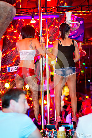 Women dancing on the pole in the nightclub of Patong Editorial Image