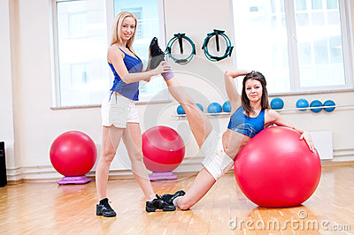 Women do stretching exercise