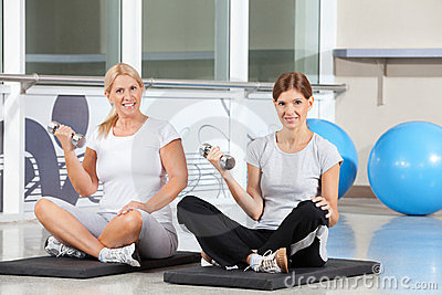 Women doing dumbbell exercises