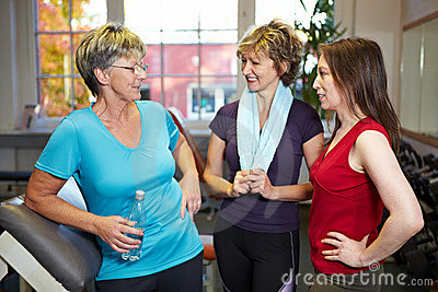 Women doing small talk in gym