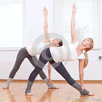 Women doing yoga exercise at gym