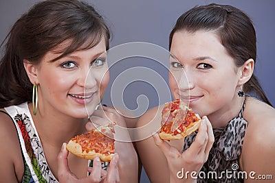 Women eating pizzas