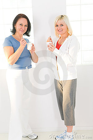 Women eating yoghurt