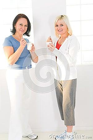 Women eating yoghurt