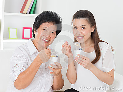 Women eating yogurt.