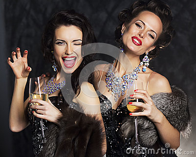 Women in elegant dress with champagne - nightlife
