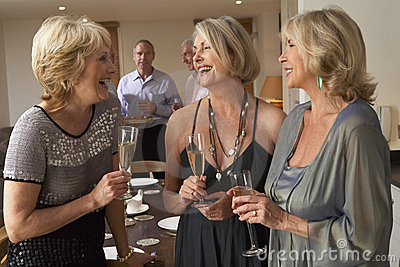 Women Enjoying Champagne At A Dinner Party