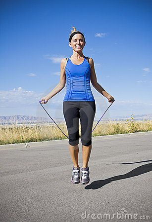 Women Exercising and Jumping Rope