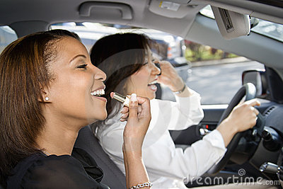 Women friends in car.