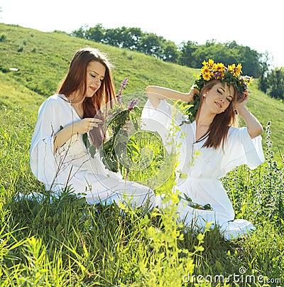 Women garlanding flowers