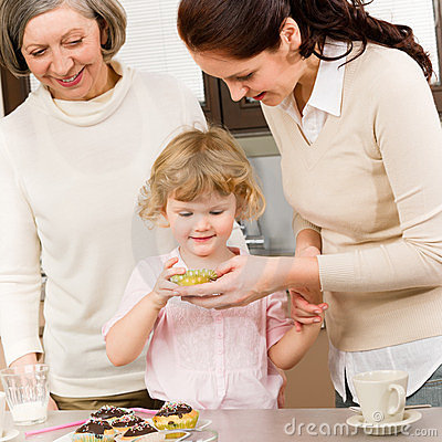 Women generations around cupcake cookies