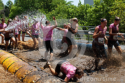 Women Get Sprayed With Fire Hose In Mud Pit Editorial Photo