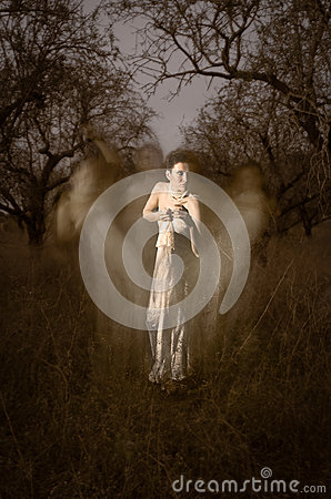 Women ghost in white surrounded by mystical silhouettes