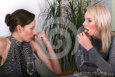 Women Gossiping and eating
