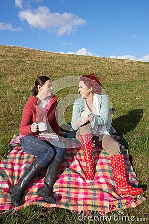 Women having country picnic