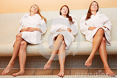 Women on heated bench relaxing