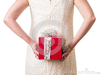 Women hiding a Christmas gift
