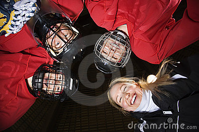 Women hockey player huddle.