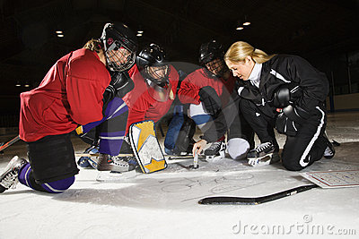 Women hockey players.