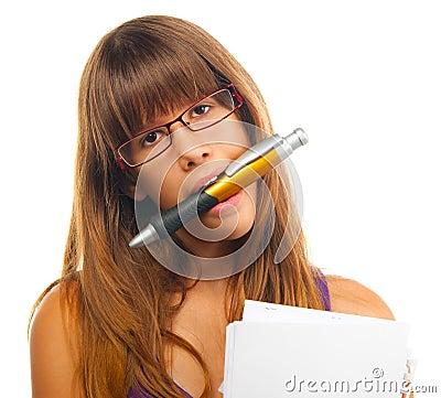 Women holding huge pencil between her teeth