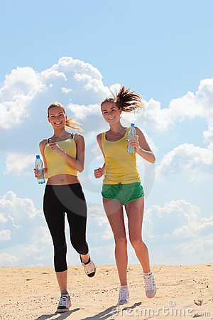 Women jogging on beach