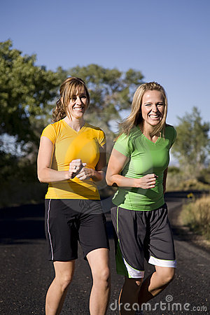 Women jogging and laughingf