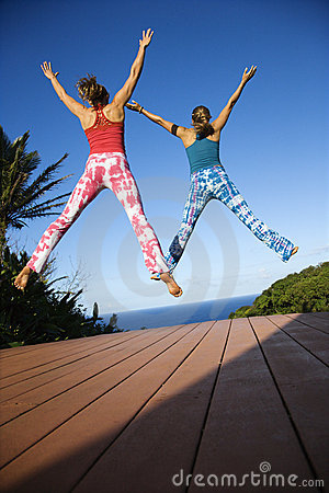 Women jumping into air.