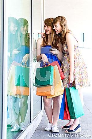 Women looking in shop window