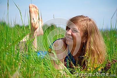 Women lying in meadow