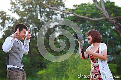 Women and man take a photo