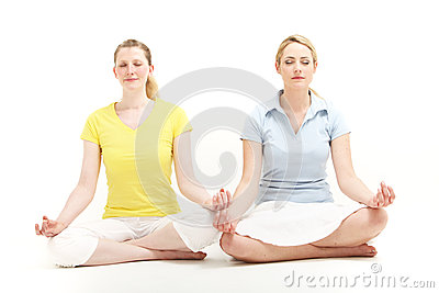 Women meditating together