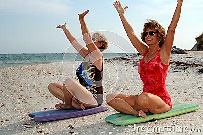 Women meditation on beach