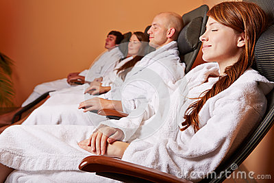 Women and men in relaxation room