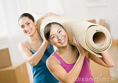 Women moving into new home and carrying rub