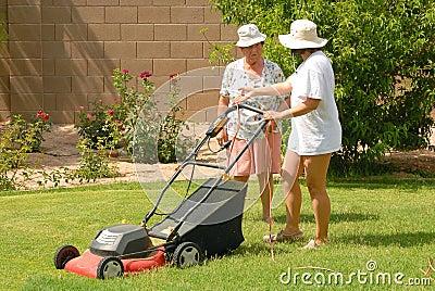 Women Mowing lawn