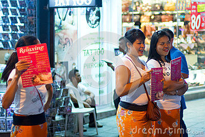 Women offering massage on the street of Patong at night Editorial Image