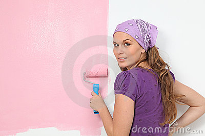 Women painting nursery wall