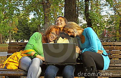 Women in park with laptop