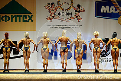 Women-participants stand with backs to audience Editorial Stock Photo