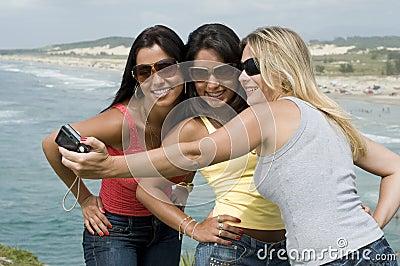 Women photograph on the beach