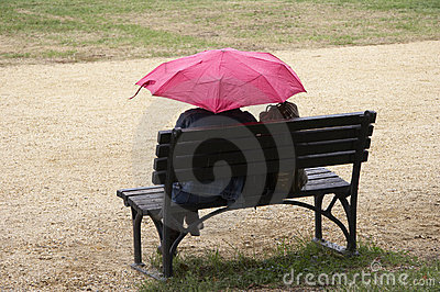 Women with pink umbrella
