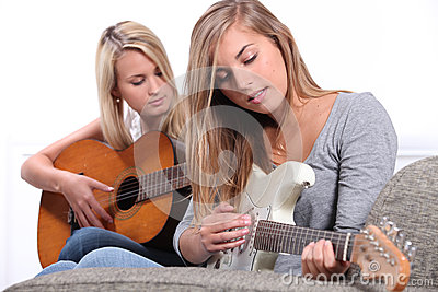 Women playing the guitar.