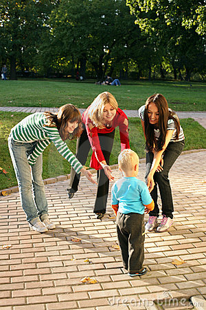 Women playing with small boy