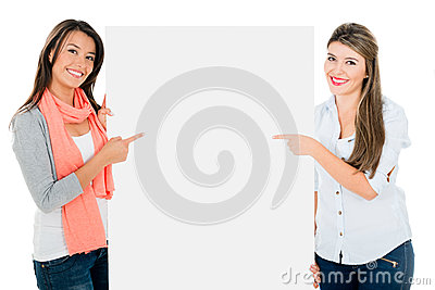 Women pointing a banner