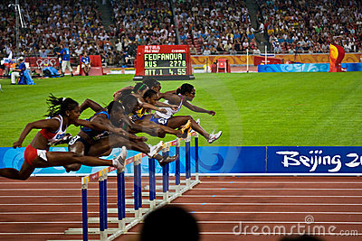Women racing 100M hurdles Editorial Photography