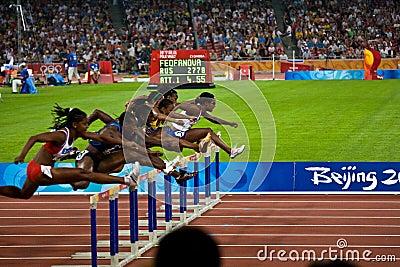 Women racing 100M hurdles Editorial Photography