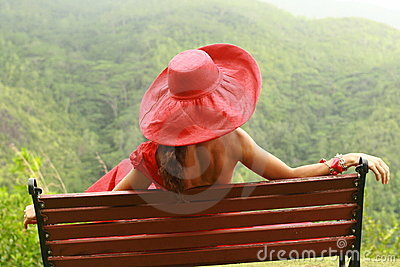Women with red hat on the bench