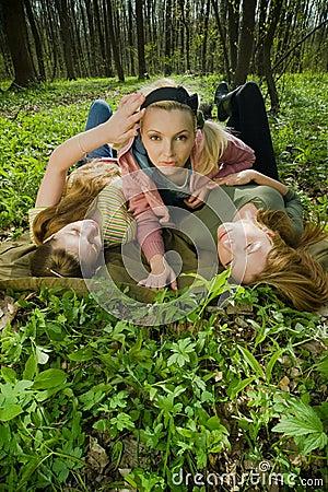 Women relaxing in forest