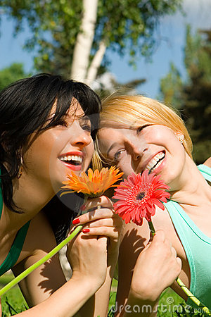 Women rest in the park with flowers